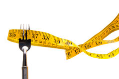 Tape measure stuck on fork Royalty Free Stock Photo