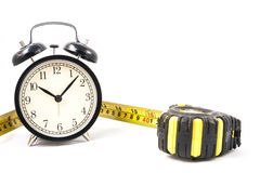 Tape measure tape measure with clock in. White Royalty Free Stock Photos