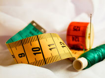 Tape measure, thread, needle Royalty Free Stock Photos