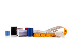 Tape measure and thread on white Stock Photo
