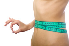 Tape measure on waist and simbol okey isolated Stock Images