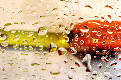 Tape measure through water drops. Stock Image