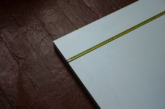 Measurement of the chipboard. Tape measure on the white chipboard. Carpentry Royalty Free Stock Photos