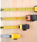 Tape measure on wood brick solated at white Royalty Free Stock Photography
