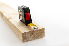 Tape measure on wood Royalty Free Stock Image