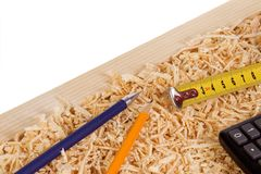 Tape measure and wood sawdust Stock Photo