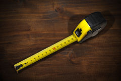 Tape Measure on a Wooden Work Table Royalty Free Stock Image