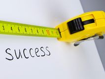 Tape Measure and the Word Success Written on a. Success measuring aspirations tape measure concept isolated measure of success Stock Image