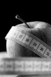 Tape measure wound around an apple Stock Photography