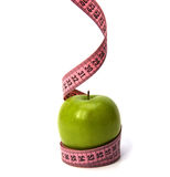 Tape measure wrapped around the apple royalty free stock images