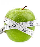 Tape measure wrapped around the apple. Isolated on white background Royalty Free Stock Photo