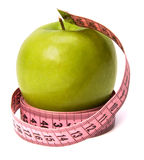 Tape measure wrapped around the apple isolated Royalty Free Stock Photography