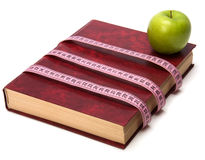 Tape measure wrapped around book Stock Image
