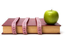 Tape measure wrapped around book Royalty Free Stock Photos