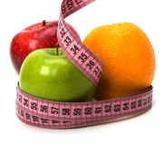 Tape measure wrapped around fruits Royalty Free Stock Images