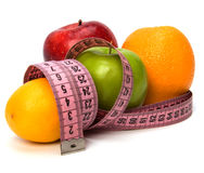 Tape measure wrapped around fruits Stock Photo