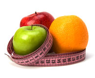 Tape measure wrapped around fruits Royalty Free Stock Image