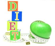 Tape measure wrapped around green apple Royalty Free Stock Photo