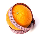 Tape measure wrapped around the orange Royalty Free Stock Images