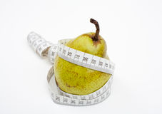 Tape measure wrapped around pear Stock Photo