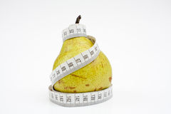 Tape measure wrapped around pear Royalty Free Stock Photos
