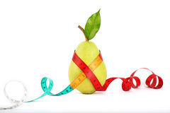 Tape measure wrapped around pear Royalty Free Stock Image
