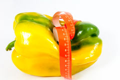 Tape measure around pepper Stock Image