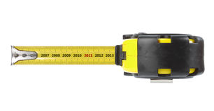 Tape measure with year concept Royalty Free Stock Photo