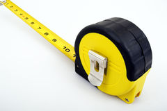 Tape Measure. A yellow tape measure isolated on a white background with copy space Stock Photos