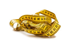 Tape Measure. Yellow tape measure   on white background Royalty Free Stock Images