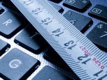 Free Tape Measurer On Laptop Keyboard . Stock Photos - 108690403