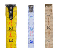Tape measures. Antique folding style tape measure by new Stock Photography