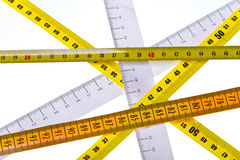 Tape measures cross Royalty Free Stock Photography