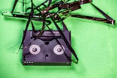 Tape pulled out from mini dv format video cassette tape.  stock photography