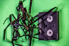 Tape pulled out from mini dv format video cassette tape.  stock images