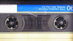 Tape Recorder Plays Audio Cassette inserted therein. Vintage Audio Tape. Macro static camera view of retro audio cassette tape with a blank label used for stock video