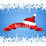 Tape with the word big sale and hat of Santa Claus Royalty Free Stock Photo