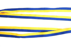 Tape. Yellow-blue ribbon for medals in the sport Royalty Free Stock Images