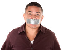 Taped Mouth Hispanic man Stock Images