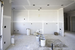 Taped and mudded kitchen new home construction. Sheet rocked room in new construction Royalty Free Stock Images