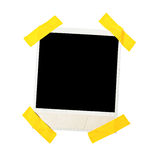 Taped polaroid style photo frame. Isolated on white Royalty Free Stock Images