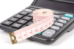 Tapeline and calculator Royalty Free Stock Image