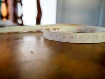 Tapeline en la tabla Fotografía de archivo libre de regalías