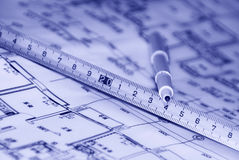 Tapeline and plan. A pen and a tapeline on a architects plan Stock Images