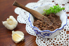 Tapenade appetizer with basil and garlic in a rust Stock Image