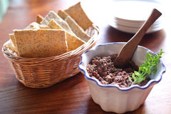Tapenade olive spread with poppyseed crackers Stock Photo