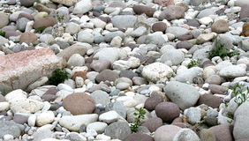 Tapered and rounded pebbles on the shore of the river in Norther Royalty Free Stock Photo