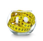 Tapes measuring in glass jar Royalty Free Stock Images