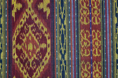 Tapestry Background. A woven tapestry background of red, gold, blues and blacks Stock Image