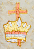 Tapestry with crown of life and cross. Royalty Free Stock Image